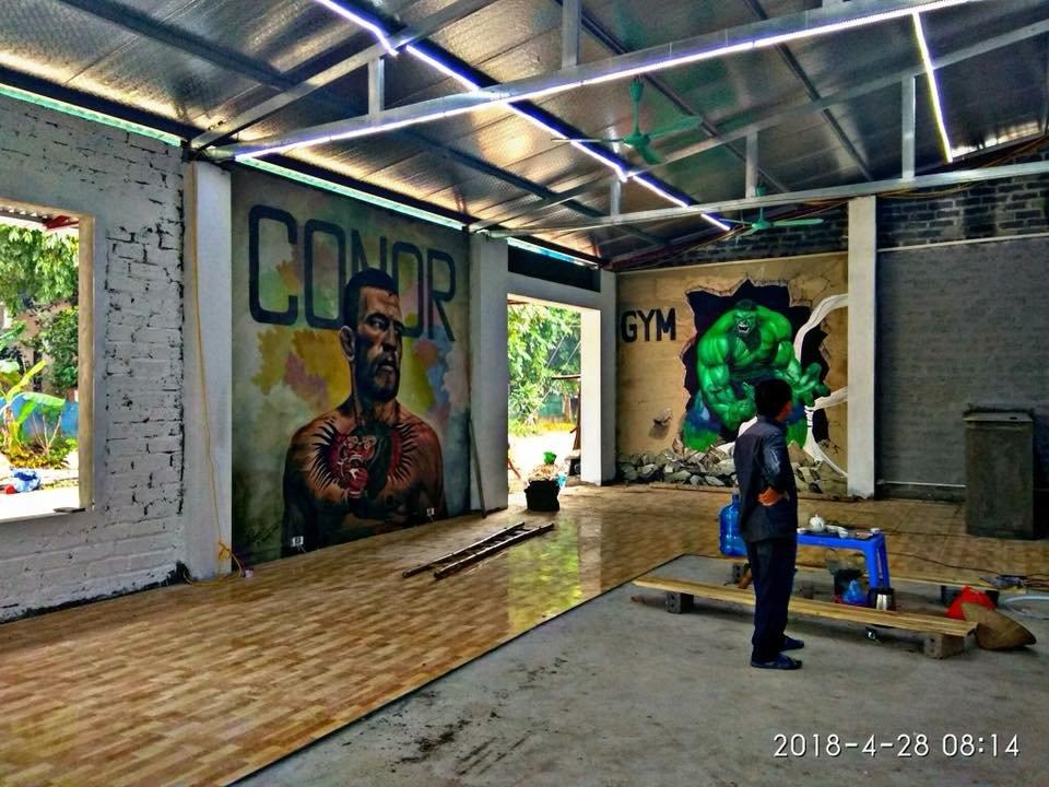 vẽ tranh tường graffiti trang trí phòng tập gym